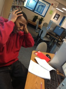 (Photo courtesy of Brenda Hernandez) Zurich Simon, senior, working in the OHS library, stressing over his senior ex revisions.