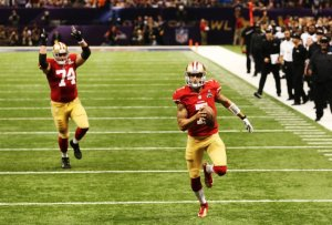 (Photo Courtesy to Bleachreport) Colin Kaepernick (number 7)rushing in for a touchdown and Joe Stanley (number 74) cheering for him on his way to the touchdown.