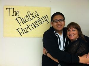 (Photo Courtesy of Denise Hensley) Desmond Garrido, senior, hugging Mary Bier, the adviser of the Pacifica Partnership.