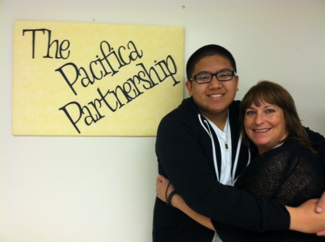 (Photo Courtesy of Denise Hensley) Desmond Garrido, senior, hugging Mary Bier, the adviser of the Pacifica Partnership.