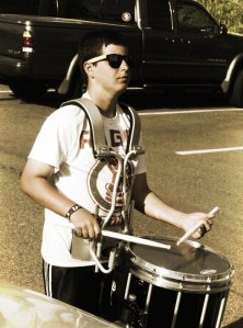 (Photo Courtesy of Michael Toland) Michael drums along in a parking lot on his way to community service.