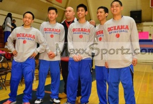 (Photo Courtesy of MaxxSportz.com) The seniors on the team with big smiles on their faces before tip-off.  From (left to right)