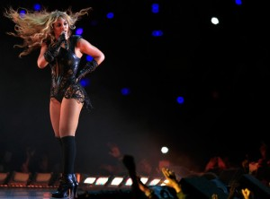 (Photo Courtesy of E!) Beyonce singing at her Super Bowl Half Time concert.