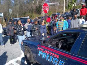 (Photo courtesy of CNN)Parents gather outside as the school is on lockdown.