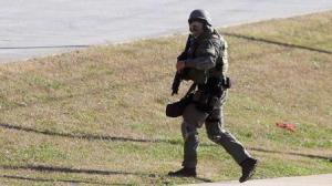 (Photo Courtesy of John Bazemore)SWAT team responds at the school after the shooting.