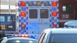 (Photo Courtesy of WSB Channel 2 Action News)Paramedics and other emergency vehicles gather outside the school.
