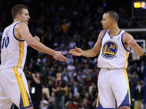 (Photo Courtesy of warriors.com) Stephen Curry and David Lee giving each other a high-five after Curry threw Lee a dime.