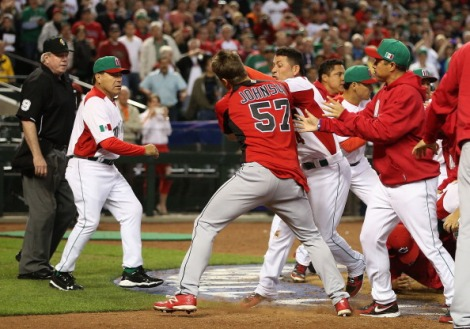(Photo Courtesy of ESPN)  Both dugouts run out and brawl at a WBC game.