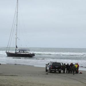 (Photo Courtesy of Jane Northrop)The Pacifica police and a group of rescue swimmers coordinate their efforts in order to reach the suspects aboard the yacht.