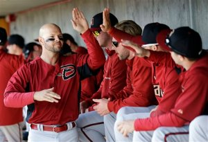 (Photo Courtesy of sfgate.com) Cody Ross giving high fives to his new teammates after scoring a run.
