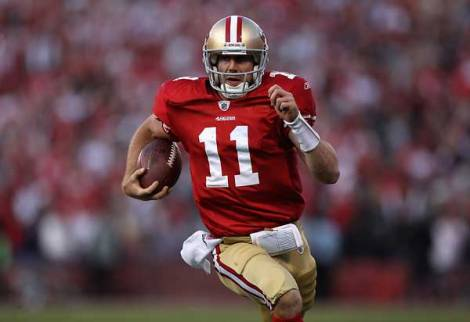 (Photo courtesy of Denver Post)  Alex Smith rushing the ball for a touchdown.
