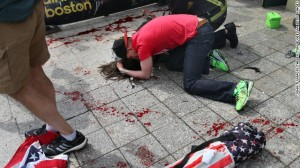 Immediately after the blasts, everyone stepped up to help the injured. Photo courtesy of CNN.com