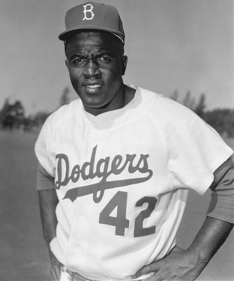 (Photo Courtesy of MLB.com)  Jackie Robinson sporting his Brooklyn Dodgers jersey when he first entered the Major League.