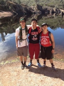 (Photo Courtesy of Ms. Mcenany) Left to right, Aaron Patterson, James Garcia, and Maria Feeney, enjoy a break at the reservoir during camping interim