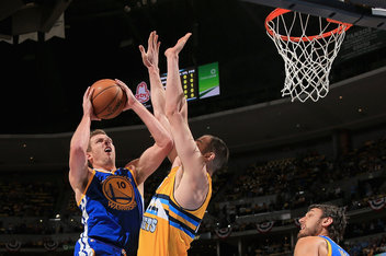 (Photo Courtesy of SB Nation) David Lee (Number 10) driving hard to the line trying to score on Kosta Koufos.
