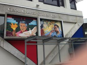 (Photo Courtesy of Max Escajadillo) Two murals located in San Francisco representing Cezar Chavez and Malcolm.