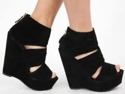 (Photo Courtesy of Agac'i) Black cutout open-toe wedges.