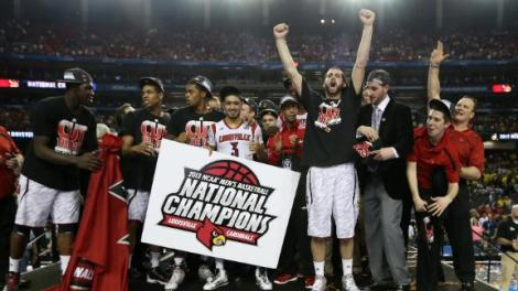 (Photo Courtesy to ESPN)  Louisville on stage screaming with lots of joy and about to receive the National Championship trophy.