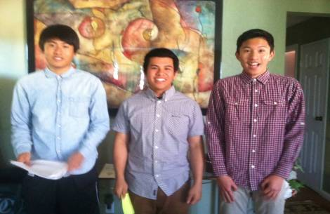 Caption: Ryan Briosos, Alex Cote, and Nathan Lumanlan stand triumphant after finishing their Relfection Project