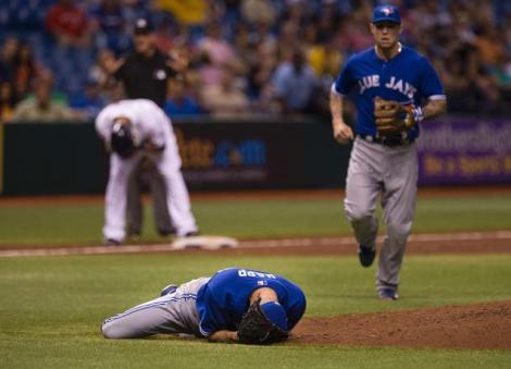 (Photo Courtesy of New York Daily News)  J.A. Happ lying face down after he got drilled on the head by a line drive.