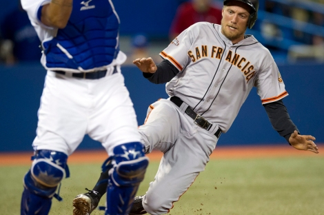 (Photo courtesy of sfexaminer.com) Hunter Pence and Henry Blanco almost collide at the plate.