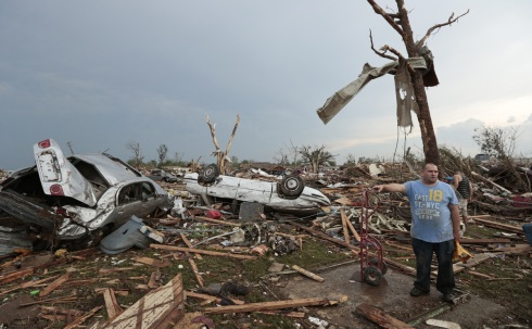 (Photo Courtesy of Brett Deering/Getty Images) Philip Gotcher stands in the rubble of his destroyed house.