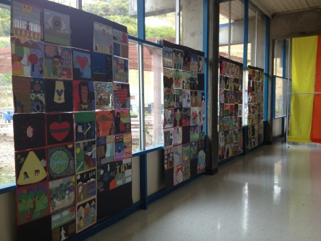 (Photo courtesy of Bridget Pocasangre) Picture quilts made by the sophomore humanities classes on display at BAM.