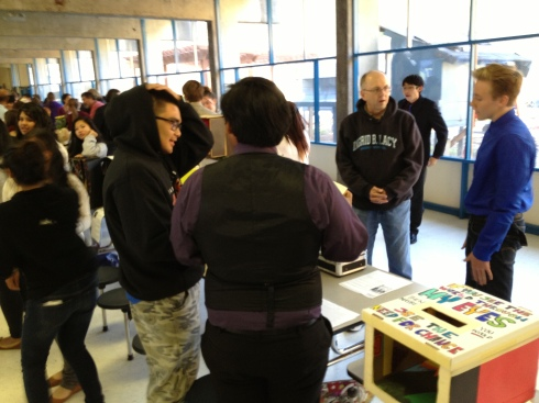 (Photo courtesy of Mr. Robledo) Sophomores speak to community members about their project.