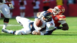 (Photo courtesy of rantsports.com) Chiefs linebacker, Justin Houston (50) sacks Denver quarterback Payton Manning (18).