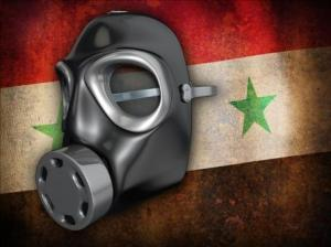 Gas mask infront of Syrian flag. ~Photo courtesy of Leslie Dyste