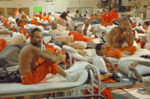 Photo courtesy of understandinggov.org. this photo is showing prisons are getting very overcrowded by having so many bunks close together in one room.
