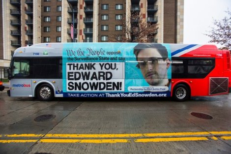 An urban bus in Washington with an advertisement about Edward J. Snowden sponsored by the Partnership for Civil Justice Fund. Photo Courtesy of Jim Lo Scalzo/European Pressphoto Agency.