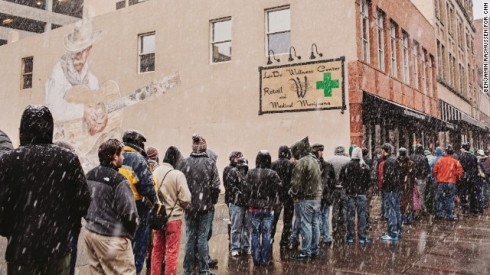 People waiting in the snow to purchase cannabis. ~Photo courtesy of CNN.