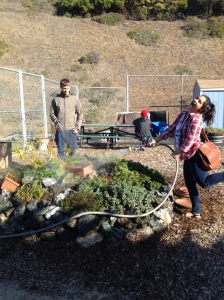Junior Arne Jonssen and Junior Mireya Leiva having fun watering plants in the garden. Photo courtesy of Bridget Pocasangre