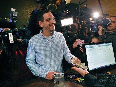 Sean Azzariti, war vet, being the first to purchase legal cannabis. ~Photo courtesy of Business Insider