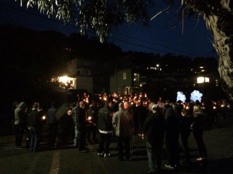 Candlelight Vigil taking place in from of Chang's house, in respect of his death. Photo courtesy of Danny Dickow